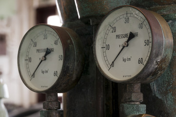 Two antique pressure gauges