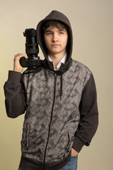 Portrait of a young photographer with a professional camera