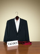 Job vacancy - desk with business suit on hanger, tie