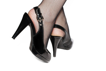 Female legs in black shoes isolated