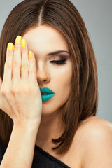 Woman face. Yellow nail. Blue lips.