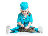 Child girl playing doctor with cat kitten