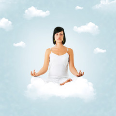 girl sitting on cloud, meditating, and floating on the sky