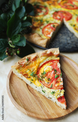 Slice of homemade tomato pie, pizza or quiche