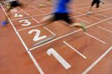 Fototapety Athletes cross the finish line