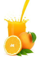 Orange juice pouring into a glass with splash.