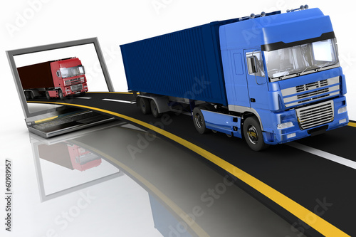 Trucks on freeway coming out of a laptop