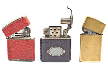 Three vintage cigarette lighters  isolated on white
