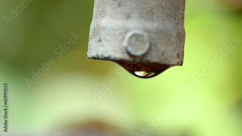 Water drop with valve and green background