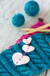 Knitting pattern and needles on a wooden background
