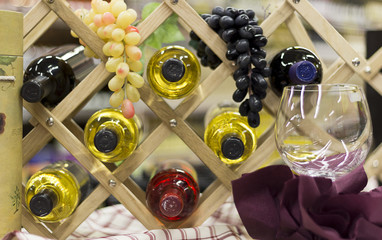 Bottles of Wine and Grapes