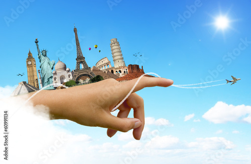 Travel the world hand monuments concept
