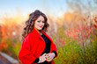 portrait of a fabulously beautiful girl in a red coat