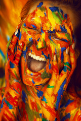 Sensual woman in paint screaming