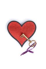 gold key on a heart