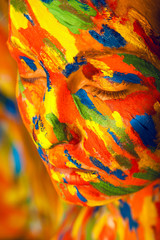 woman in colourful paint on skin
