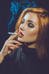 smoking red hair woman in studio