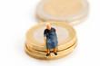 Leinwanddruck Bild Seniorin sitzen auf Muenzstapel