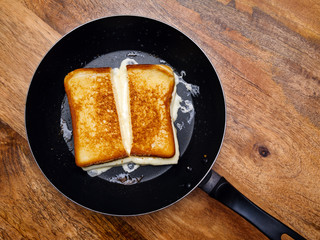 Grilled cheese sandwich on skillet