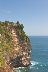 Steep cliff over the ocean at Uluwatu temple, Bali, Indonesia.