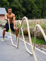 Outdoor fitness with training ropes