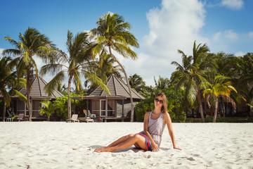 Girl on the white sandy beach (Maldives - Lhaviyani Atoll)