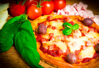 Homemade pizza with ham and olives