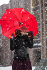 Woman with umbrella and snowfall freez