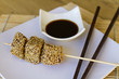 Skewer of cubes of tuna coated in sesame soy sauce
