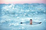 Winter swimming. Man in an ice-hole