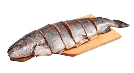 Fresh trout on wooden cutting board, isolated on white backgroun