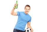 Euphoric fan holding a beer bottle and football cheering