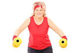 Middle aged woman exercising with dumbbells