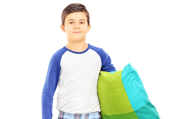 Boy in pajamas holding a pillow