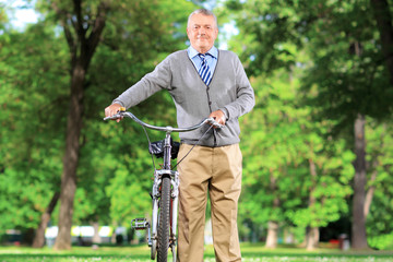 Mature man with his bicycle in park