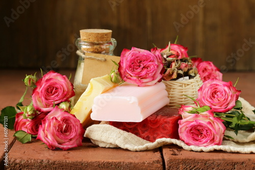 handmade soap with the scent of roses on a wooden table