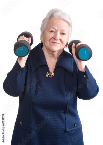 Happy old woman making fitness training with dumbbells
