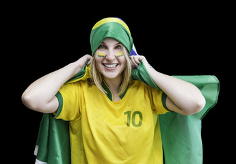 Woman holds a brazilian flag on the black background