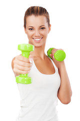Happy blonde female exercising with weights
