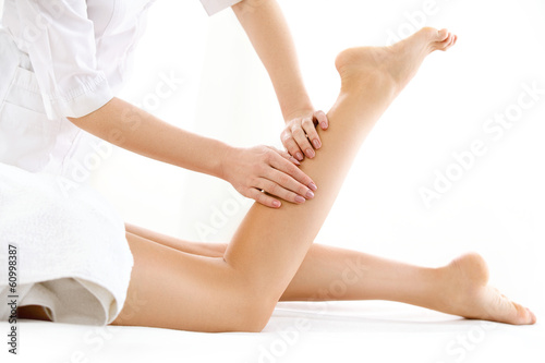 Foot Massage in the Spa Salon isolated on White