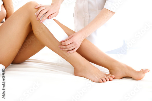 Well-groomed Woman Legs After Depilation Isolated on White Backg