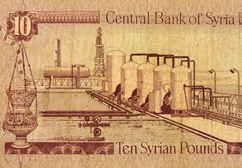 Ten Syrian pounds banknote fragment macro