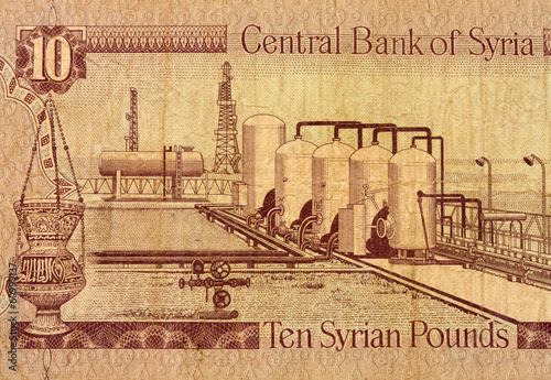 Ten Syrian pounds banknote fragment macro