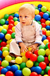 Child in colored ball.