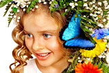 Little girl with flower hairstyle.