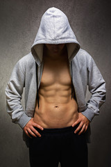 Muscular guy with hoodie after workout