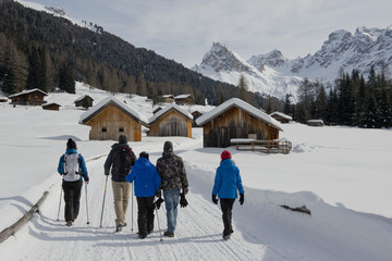 Group Hiking on a snowy Trail to mountain Huts