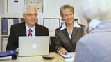 Senior business people giving handshake