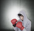 teen boy training with red boxing gloves