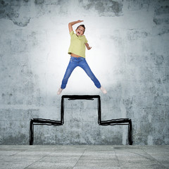 young woman jumping at the top of the podium